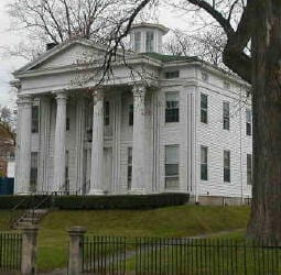This Greek Revival building could be a home, a school, a church, or the Town Hall.