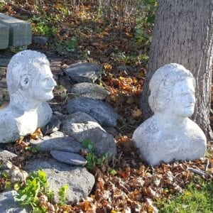 Two primitive cement busts of 19th. Century American gntlemen.