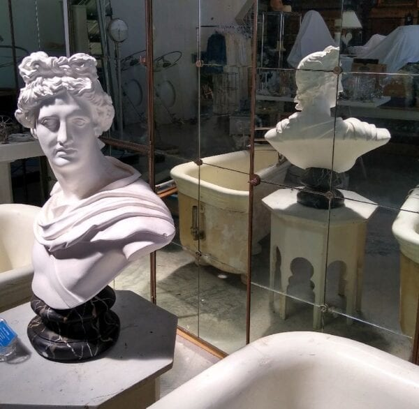 Plaster bust of classical male figure.