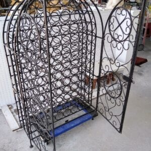 Standing iron wine rack with room for 92 bottles.